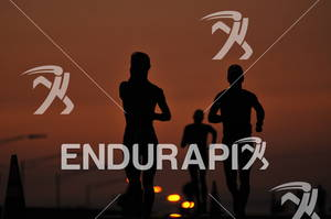Runners silhouetted by the sunset in the 2010 Ford Ironman World Championship.