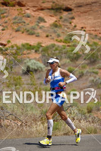 Uli Bromme strides through Pioneer Park on the run portion of the 2011 Ford Ironman St. George Utah May 7, 2011.