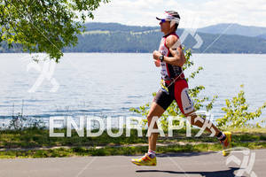 Craig Alexander runs along Lake Coeur d' Alene at the 2011 Ford Ironman Coeur d' Alene
