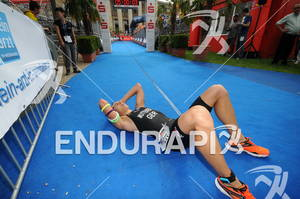 Julian Mutterer (GER) is exhausted after his finish at the Sparkassen Finanzgruppe IRONMAN 70.3 European Championship in Wiesbaden, Germany August 14, 2011