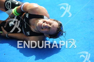 Jenny Schulz (GER) has a painful convulsion after her finish at the Sparkassen Finanzgruppe IRONMAN 70.3 European Championship in Wiesbaden, Germany August 14, 2011