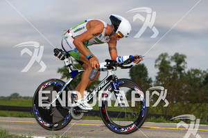 Chris McDonald (AUS) puts back 1st Endurance bottle during bike at the 2011 Ford Ironman Louisville