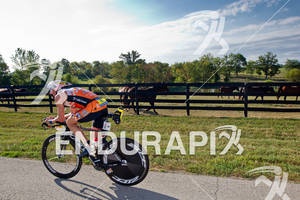 Patrick Evoe (USA) bikes past one of the many horse farms at the 2011 Ford Ironman Louisville