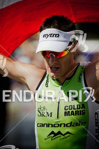 Michael Weiss (AUS) at finish line after competing in the Ironman World Championship 70.3 in Las Vegas, NV. September 11, 2011