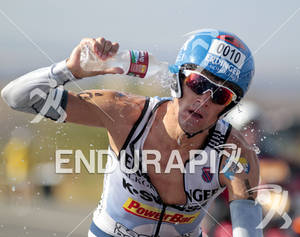 Andreas Raelert cools down as he passes an aid station on the bike portion of the 2011 Ford Ironman World Championship in Kailua-Kona, HI. October 8, 2011.