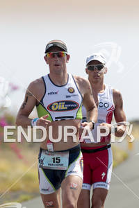 Frederik Van Lierde (15) and Rasmus  Henning (27)  competing in the run portion of the 2011 Ford Ironman World Championship in Kailua-Kona,HI. October 8, 2011.