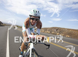 Julie Dibens (GBR) clowns for the camera during the bike leg of the 2011 Ford Ironman World Championship