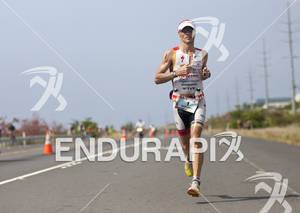 Craig Alexander runs along the Queen K in the closing miles of the 2011 Ford Ironman World Championship