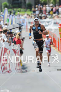 Mike Aigroz at Hot Corner running up Palani Road after T2 at the run portion of the 2011 Ford Ironman World Championship in Kailua-Kona. HI, October 8 2011