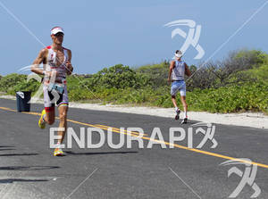 Craig Alexander of Australia and Andreas Raelert of Germany near the NELH run turn at the 2011 Ford Ironman World Championship in Kailua-Kona, Hawaii. 8 October 2011.