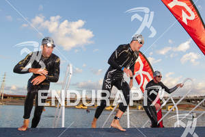 Eneko Llanos and Paul Amey exit water together and would spend much of the day fighting it out at the 2011 Ford Ironman Arizona