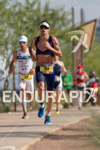 Paul Amey pases Eneko Llanos on the run 2011 Ford Ironman Arizona