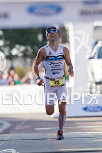 Eneko Llanos (SPA) runs down finish shoot to win the 2011 Ford Ironman Arizona