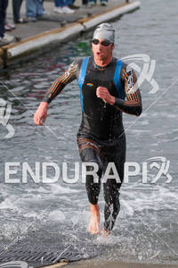 John Dahlz exits water at the  Ironman 70.3 California on March 31, 2012  in Oceanside, CA