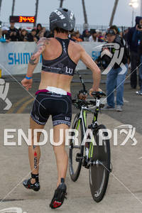 Heather Jackson exits T1 at the  Ironman 70.3 California on March 31, 2012  in Oceanside, CA
