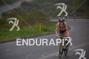 Heather Jackson climbs at the  Ironman 70.3 California on March 31, 2012  in Oceanside, CA