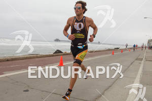 Jesse Thomas runs along the Strand at the  Ironman 70.3 California on March 31, 2012  in Oceanside, CA