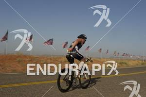 Heath Thurston fills his hydration reservoir while competing in the bike portion of the Ironman St. George in St. George, Utah May 5, 2012.