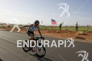 Chris McDonald grabs water at an aid station while competing in the bike portion of the Ironman St. George in St. George, Utah May 5, 2012.