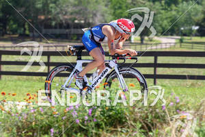 Mary Beth Ellis rides past the Texas wildflowers rat the Ironman Texas on May 19, 2012 in The Woodlands, TX