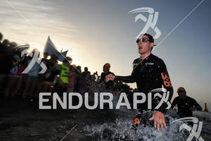 Athlete exiting the water at the swim portion of the 2012 Ironman Lanzarote May 19, 2012 in Canary Islands, Spain