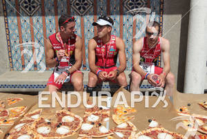 1st Sylvain SUDRIE (FRA) front of pizza's after the finish