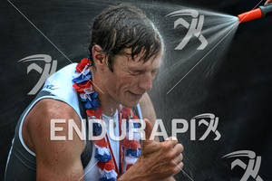 Age group athlete enjoying a shower at the finish of the Ironman Austria on July 01, 2012 in Klagenfurt, Austria
