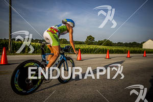Mirinda Carfrae is at the turn around on bike course heading back to T2