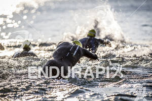 Profile Design athlete dives into the cool waters of Lake Michigan at the Ironman 70.3 Racine, in Racine, Wisconsin on July 15, 2012