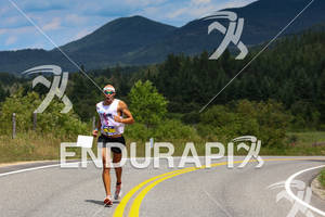 Mathew Russell runs on the second lap at the 2012 Ironman Lake Placid Triathlon in Lake Placid, NY on July 22, 2012