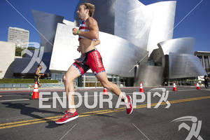 Henry Hagenbuch passes the Walt Disney Concert Hall during his first lap at the 2012 Los Angeles Triathlon on September 30, 2012 in Los Angeles, CA.