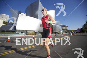 Alicia Kaye passes the Walt Disney Concert Hall during her first lap at the 2012 Los Angeles Triathlon on September 30, 2012 in Los Angeles, CA.