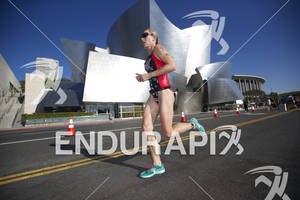 Jenna Parker passes the Walt Disney Concert Hall during her first lap at the 2012 Los Angeles Triathlon on September 30, 2012 in Los Angeles, CA.