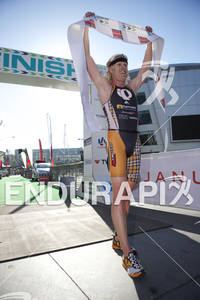 Cameron Dye celebrates his first place men's finish at the 2012 Los Angeles Triathlon on September 30, 2012 in Los Angeles, CA.