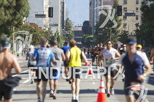 Age group triathletes make their way up and back down Grand Avenue at the 2012 Los Angeles Triathlon on September 30, 2012 in Los Angeles, CA.