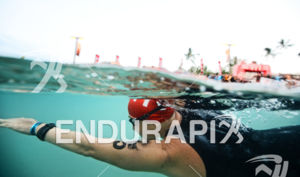 Michelle Gailey swims to the starting line before the swim at the Ironman World Championship in Kailua-Kona, Hawaii on October 13, 2012