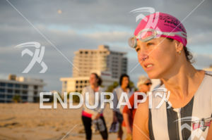 Female triathlete observes the swim course prior to the race start at the 2575 Triathlon Miami in  Fort Lauderdale, FL on March 17, 2013.