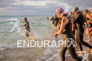 Barbara Wach (BIB #71) at female race start during the  2575 Triathlon Miami in  Fort Lauderdale, FL on March 17, 2013.