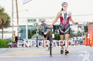 Triathlete Luisanna Rodriguez heading out of the transition to bike leg during 2575 Triathlon Miami in  Fort Lauderdale, FL on March 17, 2013.
