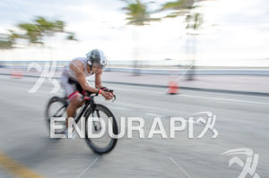 Sixth place overall Guido Perez (BIB #30) cycling during 2575 Triathlon Miami in  Fort Lauderdale, FL on March 17, 2013.