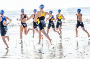Triathletes running into the water  at 2013 Joao Pessoa ITU Triathlon Premium Pan American Cup in Joao Pessoa, Brazil on April 7th, 2013.