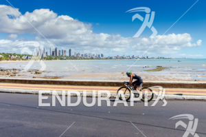Flavia Fernandes riding fast with the beautiful Joao Pessoa city on the background  at 2013 Joao Pessoa ITU Triathlon Premium Pan American Cup in Joao Pessoa, Brazil on April 7th, 2013.