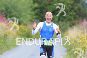 20130901 - WAISMES, BELGIUM: Illustration picture shows a happy triathlete running in the wild flowers, Sunday 1 September 2013.