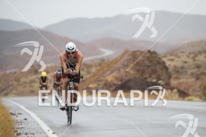 Ruedi Wild riding in the rain at the 2013 Ironman 70.3 World Championships in Las Vegas, NV on September 8, 2013.