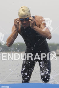 Javier Gomez Noya is first to exit the swim leg at the 2013 Beijing International Triathlon on September 21, 2013 in Beijing, China.