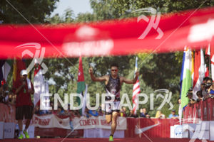 Javier Gomez Noya is victorious at the 2013 Beijing International Triathlon on September 21, 2013 in Beijing, China.