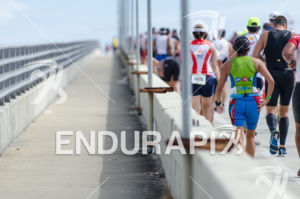 Triathletes faces the Mccarthur Causeway climb at the 2013 Ironman 70.3 Miami in Miami, Florida on October 27, 2013.