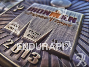 Finisher medals await their new owners at the finish line of Ironman Arizona on November 17, 2013 in Tempe, AZ.