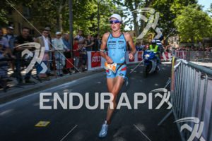 Jeanne Collonge closing the gap on the leader during the run leg of the 2014 Ironman 70.3 Pays d'Aix, Aix en Provence on May 18, 2013.