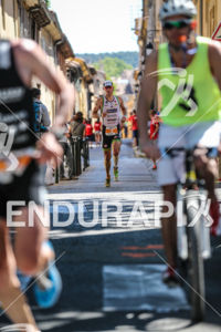 Frederik Van Lierde trying to maintain his 3rd place during the run leg of the 2014 Ironman 70.3 Pays d'Aix, Aix en Provence on May 18, 2013.